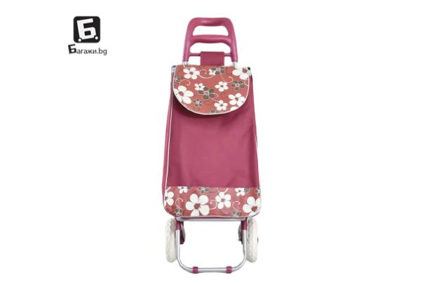 Червена пазарска количка с цветя