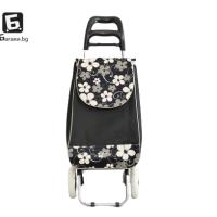 Черна пазарска количка с цветя